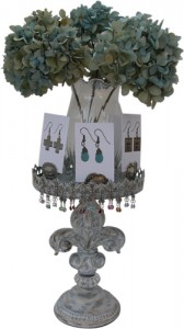 Vintage Fleur de Lis Stand to display Classic Legacy earrings topped with dried hydrangea