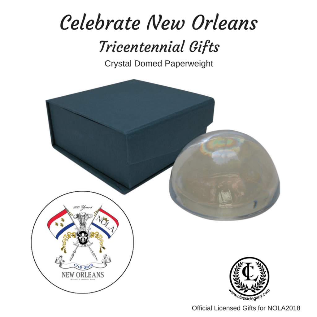 New Orleans Tricentennial gifts include this crystal domed paperweight with the NOLA2018 logo