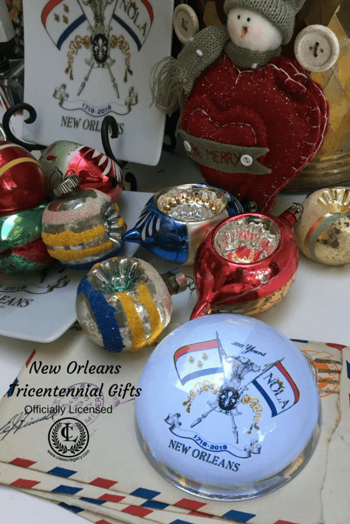 NOLA2018 Tricentennial gifts include crystal domed paperweight for Christmas